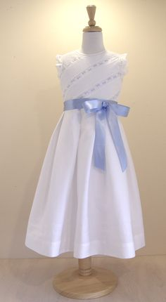 Girls in white dresses with blue satin sashes.... Cotton Pique dress with spanish embroidery