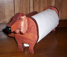 Handmade wiener dog paper towel holder. Clean up in Doxie style.
