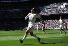 Cristiano Ronaldo of Real Madrid CF celebrates after scoring his team's 3rd goal during the La Liga match between Real Madrid CF and Granada CF at Estadio Santiago Bernabeu on April 5, 2015 in Madrid, Spain.