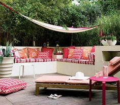Want to add a touch of fun to your outdoor space? Cue the colorful accents. A terrace gets a bold pick-me-up from cushions in vibrant colors (tangerine, fuchsia) and modern prints like ikat, stripes, and eye-popping florals.
