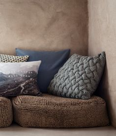 Gray. Cable-knit cushion cover with a woven cotton back section and concealed…
