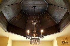 Dark stained wood ceiling treatment in master bath.