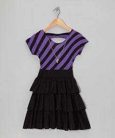Grown-up charm meets a playful bow-cut back on this striped dress. Plus, the detachable matching bow-shaped necklace can be easily unhooked from shoulder clasps for washing.