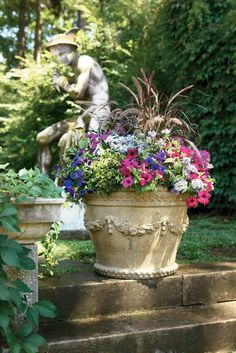 "A beautiful garden container by Proven Winners. For sun exposure. In 30"" container use 1 Graceful Grasses Purple Fountain Grass, 1 Intensia Neon Pink Phlox, 1 Supertunia Royal Velvet petunia, 1 Dark Dancer White Clover, & 1 Babylon Light Blue Verbena."