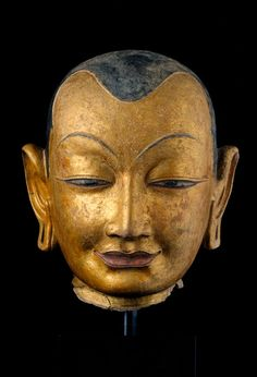Head of a Lama  (Western Tibet)  15th century  Gilt and pigment on clay composite