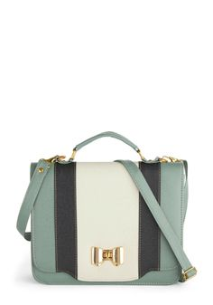 A vintage style, color blocked, handbag with a bow shaped clasp | @ModCloth