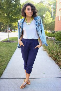 Shop this look on Lookastic:  http://lookastic.com/women/looks/crew-neck-t-shirt-and-capri-pants-and-thong-sandals-and-necklace-and-denim-jacket/4045  — Grey Crew-neck T-shirt  — Navy Capri Pants  — Grey Snake Leather Thong Sandals  — Yellow Necklace  — Light Blue Denim Jacket
