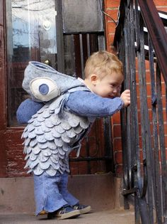 A Toddler In A Blue Fish Costume