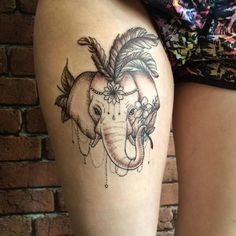 animal tattoo on thigh