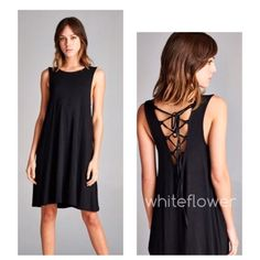 Black Lace Up Mid Length Dress. S M L Black Lace Up Mid Length Dress.   V neck back with lace up tie detail.  Flowy and soft!    Made with heavyweight kint jersey.  Drapes well!       Not a sheer fabric...available in S M L   95% Rayon, 5% spandex.     no pp/no trade Dresses Midi