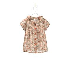 floral print shirt to wear as a dress when younger and a shirt as a toddler!  Zara $25.90