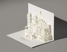 Nike WE Run London invitation / papercraft designer Federico Galvani 1) I love kirigami and popups 2) The laser cutting is really delicate and elegant 3) The gold stamping is subtle but feels very expensive.