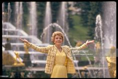 1st Lady Nancy Reagan standing in front of Samson & Lion Fountain, doing spot of sightseeing during Moscow summit.