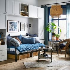 ikea bedroom ideas a blue and white studio apartment with the white wardrobe arranged around a sleeping ikea uk small bedroom ideas Living Room Zones, Living Room Decor, Small Space Living, Small Spaces, Small Rooms, White Studio Apartment, Apartment Interior, Ikea Sofas, Bedroom Arrangement