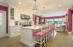I am in love with this kitchen for like a bajillion reasons. The chandeliers, The white cabinets- I LOVE white cabinets but with twin boys the white cabinets could be hard to keep white. The gold stars, the white chairs, the hint-of-hot-pink wall!!!! Not too much pink- just enough to make you smile! I don't care how impractical white cloth furniture seems- it's just gorgeous!this is my most favorite kitchen