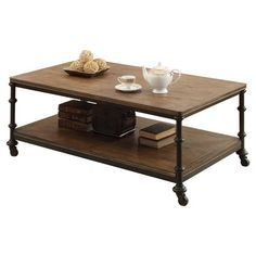 Castered coffee table with metal framing and a fixed wood shelf.  Product: Coffee tableConstruction Material: Me...
