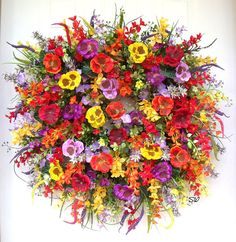 Summer Wreath, Pansy Wreath, Wildflower Wreath, Door Wreath, Wall Wreath, Between Door, Apt Condo Wreath, Purple, Orange, Yellow, Red Wreath, Housewarming gift.  Handcrafted, on a wild twiggy base, this colorful wreath is full of assorted flowers and wild grasses. I have filled this full~~ Flowers include colorful pansies, flax boxwood, wild grasses, wildflowers, flax grass, astible stems, flax greenery, wild blossoms, garden flowers, assorted filler, morning glories, berry stems and more…