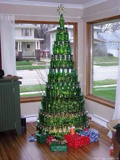 Space saving Christmas trees!  Add a little festive to your small spaces!  Creative ways to Christmas Tree!  Okay so the first one is beer bottles and would save no space at all, but the rest are pretty fun!