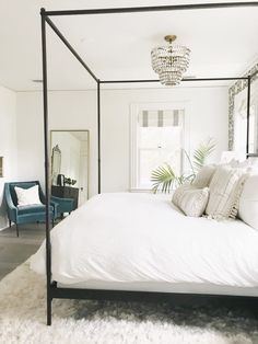 canopy bed with white bedding. White bedroom ideas, all white bedrooms, guest bedrooms that wow, guest bedrooms that make an impression, AirBnb bedroom ideas. how to have a hotel-like bedroom. clean and crisp bedroom inspiration. bedroom style, master bedroom inspo