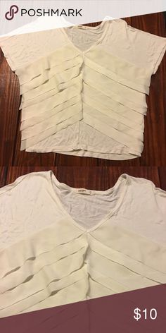 Old Navy off white top Great condition Old Navy off white/cream top. Very pretty front detail! Looks amazing with a long necklace. If you have any questions, don't hesitate to ask! And as always, I'm open to offers on all listings! Old Navy Tops