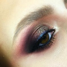 makeup @tominamakeup : bronze + charcoal blended into burgundy + soft blue liner around the eye