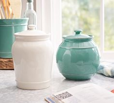 I like these two canisters. Cambria canisters. Small torquoise and tall white. $24 each