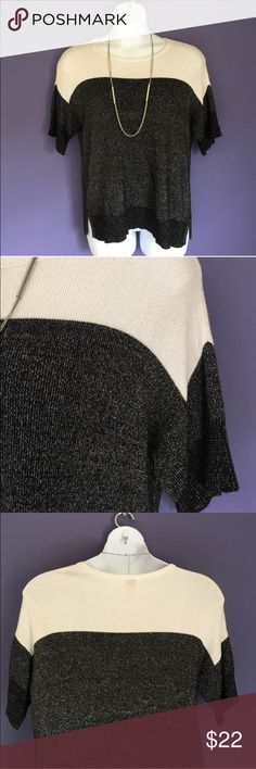 """Worthington """"Sparkle"""" Sweater Looking for a sweater with a little more pop?  You found it!  This lovely, black and cream sweater has silver """"sparkle"""" threads throughout.  Dress up or down with jewelry.  Pair with black or cream pants/skirt.  Material:  93% Rayon/7% Other Fibers. Measurements:  Length - 26.5""""/Bust - 24""""/Waist - 22"""" Worthington Sweaters"""