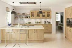 White countertop, wooden cabinet doors, white tiles