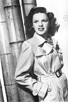 Judy Garland in a belted mac. Macs are a big trend this season, proving true style never goes out of fashion. #styleicon #glamour #retro