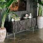 We translated the intricate design of ancient carvings to create the textural pattern of our Pictograph Buffet. Perched on Y-shaped metal legs, it's a look that reads both modern and glamorous.