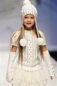 model walks the runway during the Swarovski Elements And Vogue Bambini ...