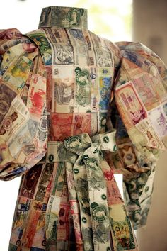 """By, Susan Stockwell:  """"Money Dress"""", 2010  Made from paper money from all over the world, stitched together. Based on the style of dress worn in the 1870's by British Female Explorers, honouring their place and role in history.    Material: paper money notes, cotton thread, frame    Provenance: London, UK"""