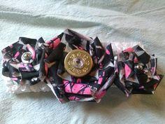 Muddy Girl camo baby headband with 12 gage primer center on Etsy, $11.00