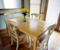 The cottage-style dining table and chairs set Emmie of Blue 11 Interiors found on Craigslist for $80 was in good condition. The construction was solid, but Emmie was concerned that the overall look was bland. Plus, the plaid seat cushions were dirty and dated.