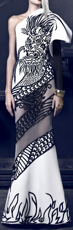 Giant dragon: YES. Mesh window basically right into your hoo-ha: NO. Nicolas Jebran Couture Fall/Winter 2014-2015