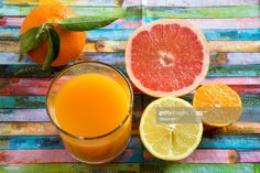 Stock Photo : Glass of multivitamine juice and differnet citrus fruits Warm Cocktails, Fun Drinks, Yummy Drinks, Healthy Drinks, Alcoholic Drinks, Beverages, Crab Stuffed Mushrooms, Fruit Juicer, Smoothie Drinks
