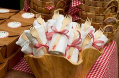 "great banana leaf individual picnic baskets and a natural wood bowl for holding napkin and fork bundles. I used waffle dishtowels purchased from Target and bamboo forks inscribed with ""Enjoy!"" in red marker."