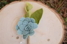 These delicate boutonnieres instantly add a touch of elegance to any mans apparel. They can be dressed down at a more casual, rustic ceremony, or dressed up for an ornate ceremony. Whatever the wedding style, these boutonnieres can be the finishing touch for a suit or tux.  This succulent boutonniere can be customized for any bridal party. Just choose the color and leave it in the note to seller box! Colors are shown in the last picture. The color of this boutonnière is blue green…