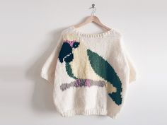 Instead of shivering your timbers in this chilly weather, try knitting up a parrot-themed jumper to take you away to a more tropical place.
