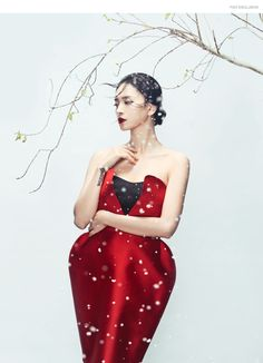 """Winter's End"" captures actress Ngo Thanh Van in a striking mix of vibrant red against snow and budding flowers. Photos by Zhang Jingna for Phuong My's holiday 2015 collection"