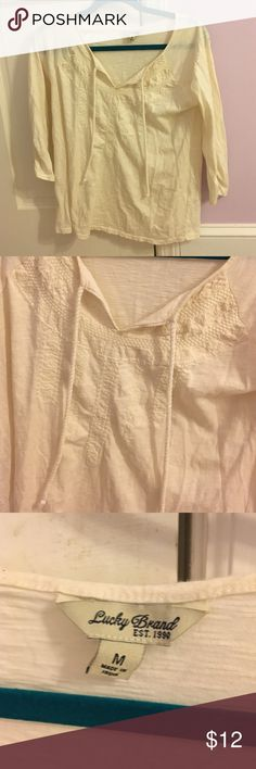 Lucky brand blouse Cream colored blouse from lucky brand. Great condition. Loose/flowly fit. Embroidered design in middle and turns into open v neck. 100% polyester Lucky Brand Tops Blouses