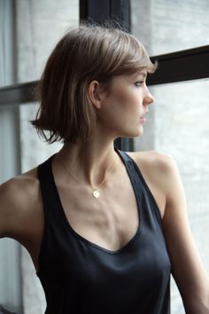 I love the simplicity of this low neck tank and the short gold necklace. :)