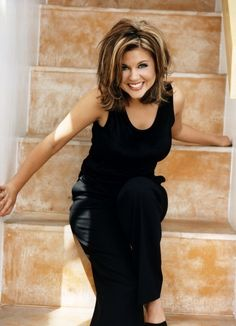 Tiffani Amber Thiessen. Love the cut and highlights!