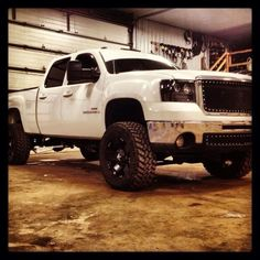 Lifted white color Chevrolet truck
