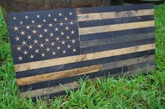 Bourbon Whiskey Barrel Flag - USA Flag Made From Oak Barrel Wood Made from retired whiskey barrels, these American flags utilize the barrels charred head as the star field, with all 50 stars individually cut out. Each stripe is alternating inside and outside pieces of the barrel staves. The outside patina'd from years of use, and the inside charred for aging spirits. Each piece is individually cut, flattened, and secured to a solid substrate.