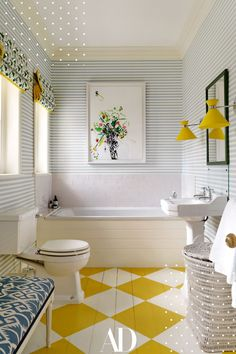 A painted floor is a great option because it is practical and you can go wild with the colors. This children's bathroom is the right amount of color and sophistication. #bathroom #tub #yellow #tile #mirror #lights #sink #laundry #windows #wallpaper English Country Style, Georgian Homes, Interior Decorating, Interior Design, Decorating Ideas, Interior Architecture, Striped Wallpaper, Mellow Yellow, Architectural Digest