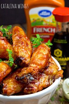 Chicken wings coated with a tangy and sweet sauce made with California French (Catalina) dressing. EVERYBODY LOVES WINGS Who doesn't love a good chicken wing? The great thing about wings is that on… Hot Wing Sauces, Chicken Wing Sauces, Baked Chicken Wings, Chicken Wing Recipes, Fried Chicken, Cooked Chicken, Catalina Dressing Recipes, Catalina Chicken, Sauce Recipes
