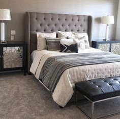A grey tufted fabric headboard pairs perfectly with leather, metals and glass accents.