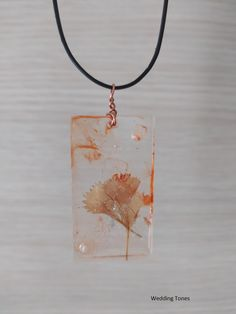 Handmade Necklace With Orange Resin Pendant With Dried Flowers And Leather Cord – Wedding Tones Crystal Necklace, Pendant Necklace, Handmade Copper, Resin Pendant, Leather Cord, Handmade Necklaces, Dried Flowers, Diy Jewelry, Pearls