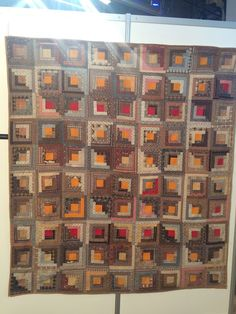Log cabin, red and gold centers, brown/greys/tans. Humble Quilts: European Patchwork Vacation Part Two